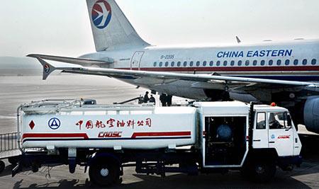 航空燃油附加费下调 航空公司获利(图)